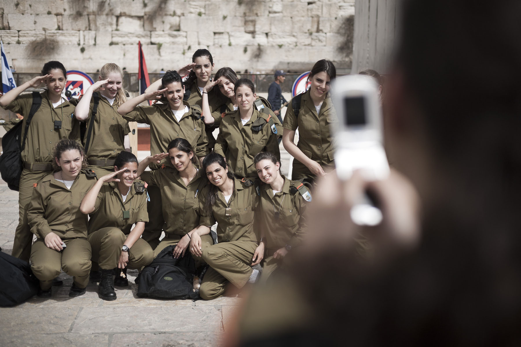 Israeli female soldiers pose in front of Western Wall. March 2008