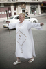 A Western woman preaches in the street in March 2008