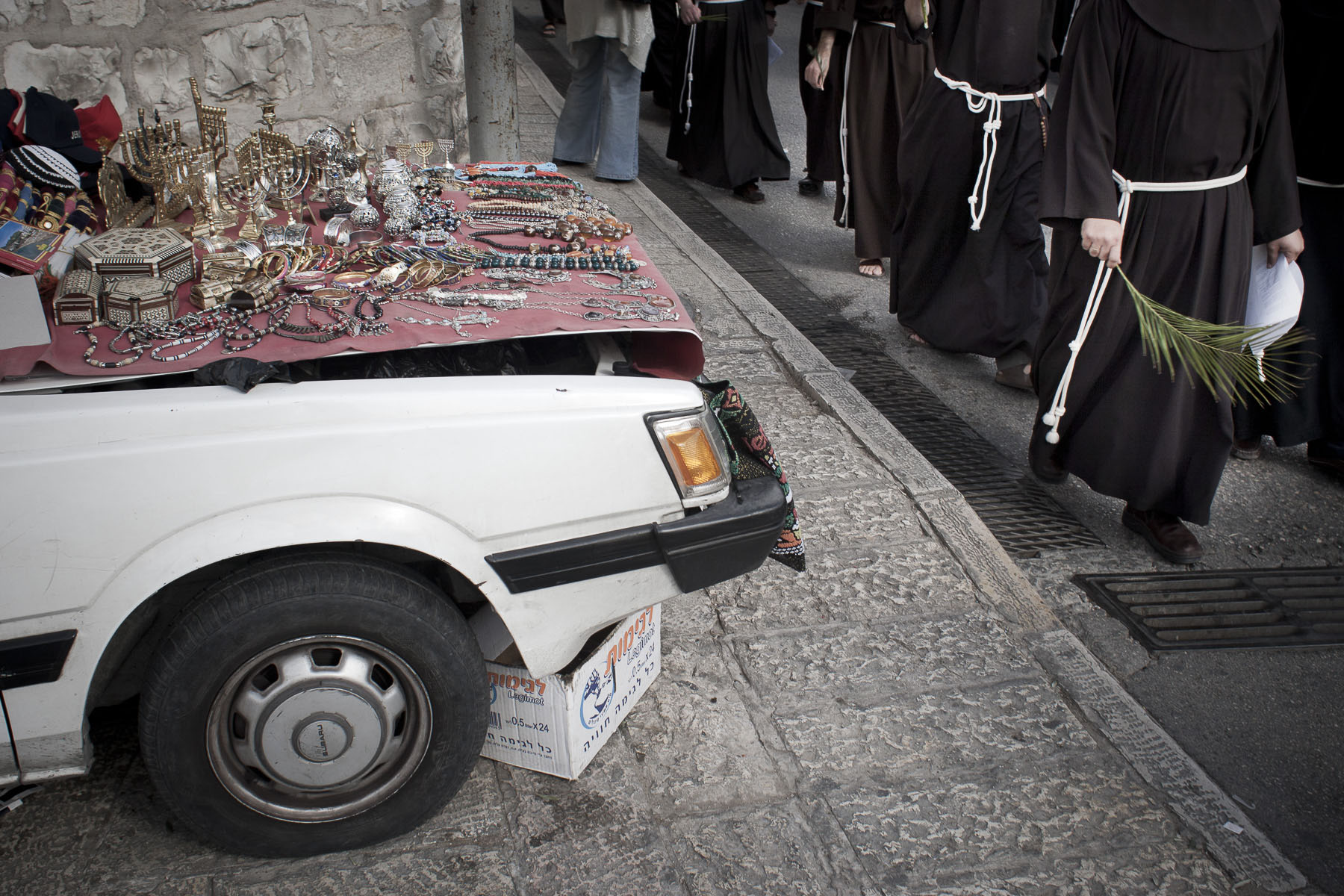 Catholic monks go down the Mount of Olives during Palm Sunday procession in April 2009