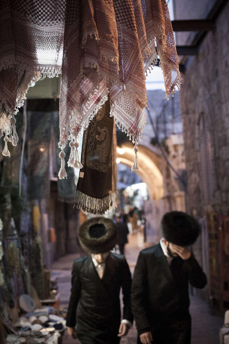 Ultra ortodox Jewish men walk to the Western Wall in April 2009