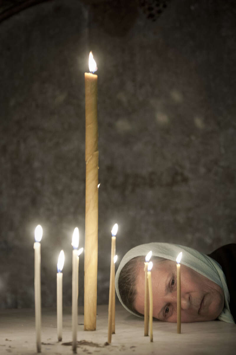 Russian Orthodox woman prays in the Holy Sepulchre in April 2009
