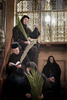 Orthodox nuns are seated in the Holy Sepulchre after during the traditional Palm Sunday in April 2009