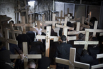 Orthodox Serbs praying in the Holy Sepulchre after the Way of the Cross procession on Good Friday in April 2009