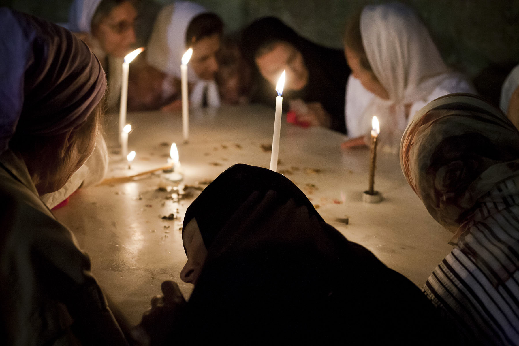 Russian Orthodox women pray in the Holy Sepulchre on Easter Day in April 2009