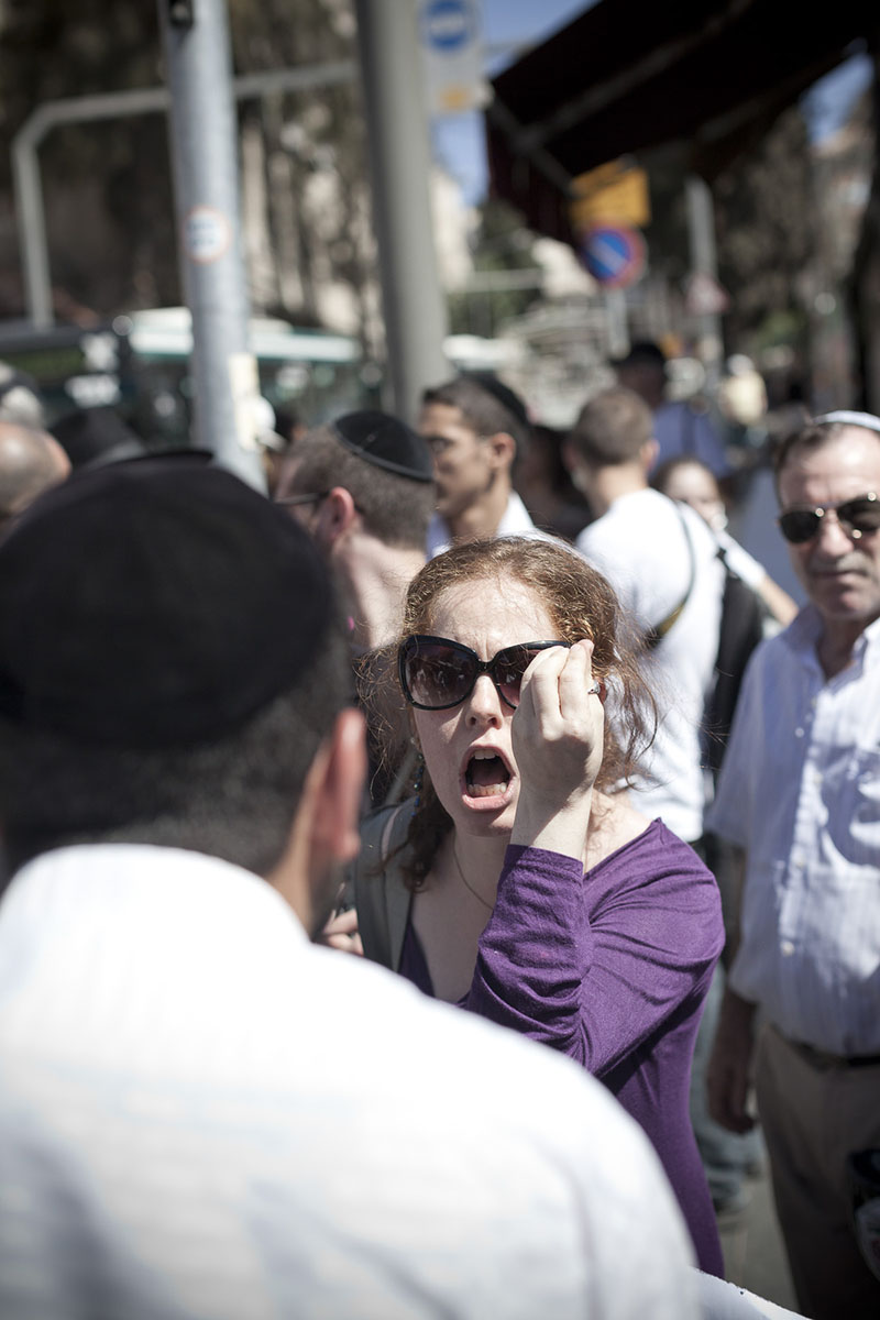 An Israeli woman facing a Jewish ultra-Orthodox during a demonstration in October 2010