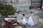 Palestinian little girls by the separation wall in October 2010