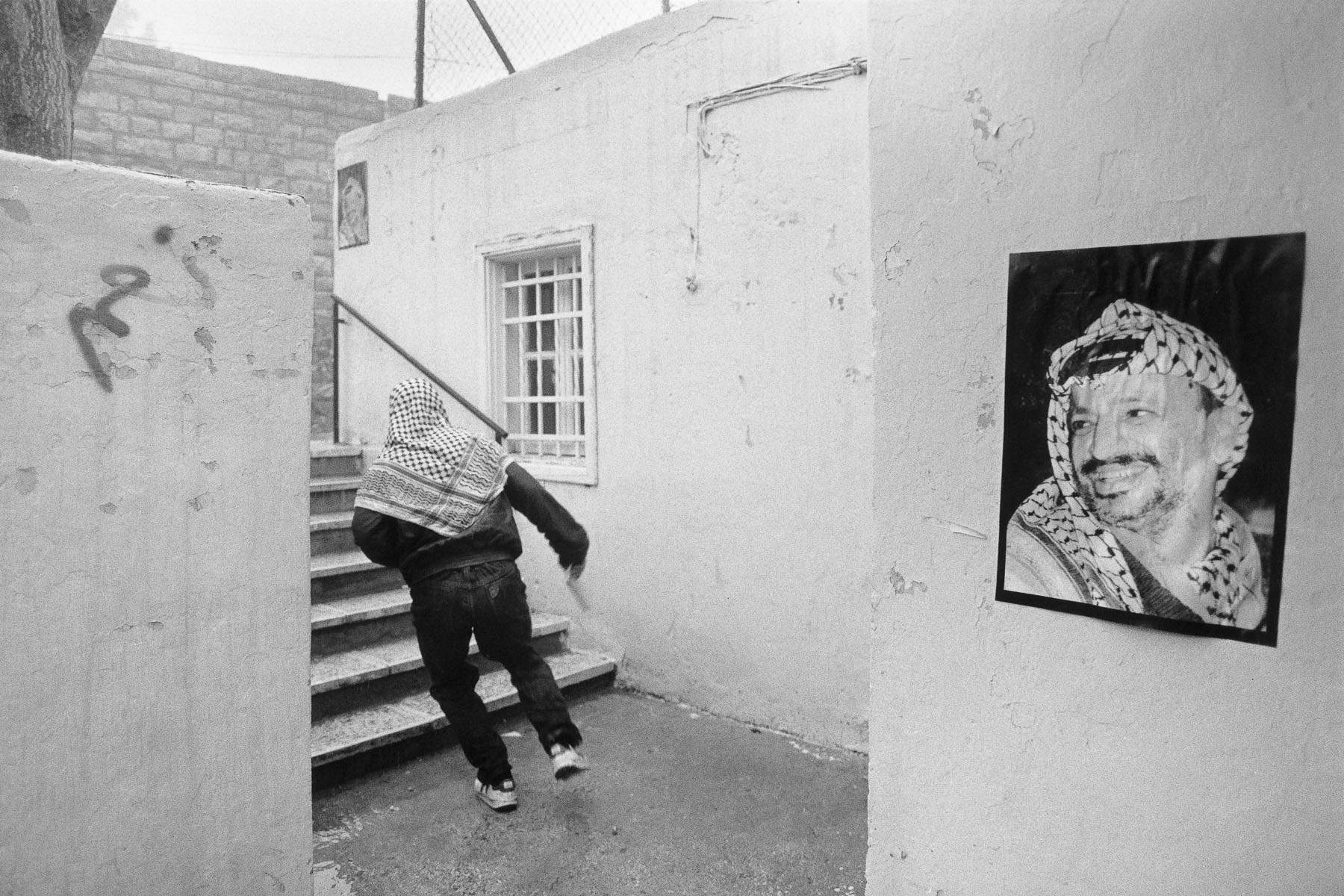 A student and Yasser Arafat's portrait at the Birzeit University in January 1988