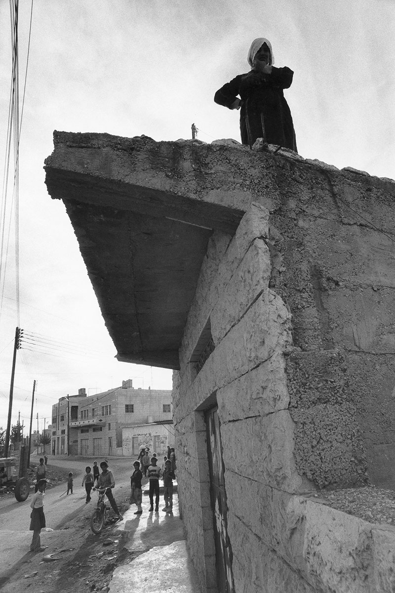 Palestinian woman on the roof of her house in December 1988