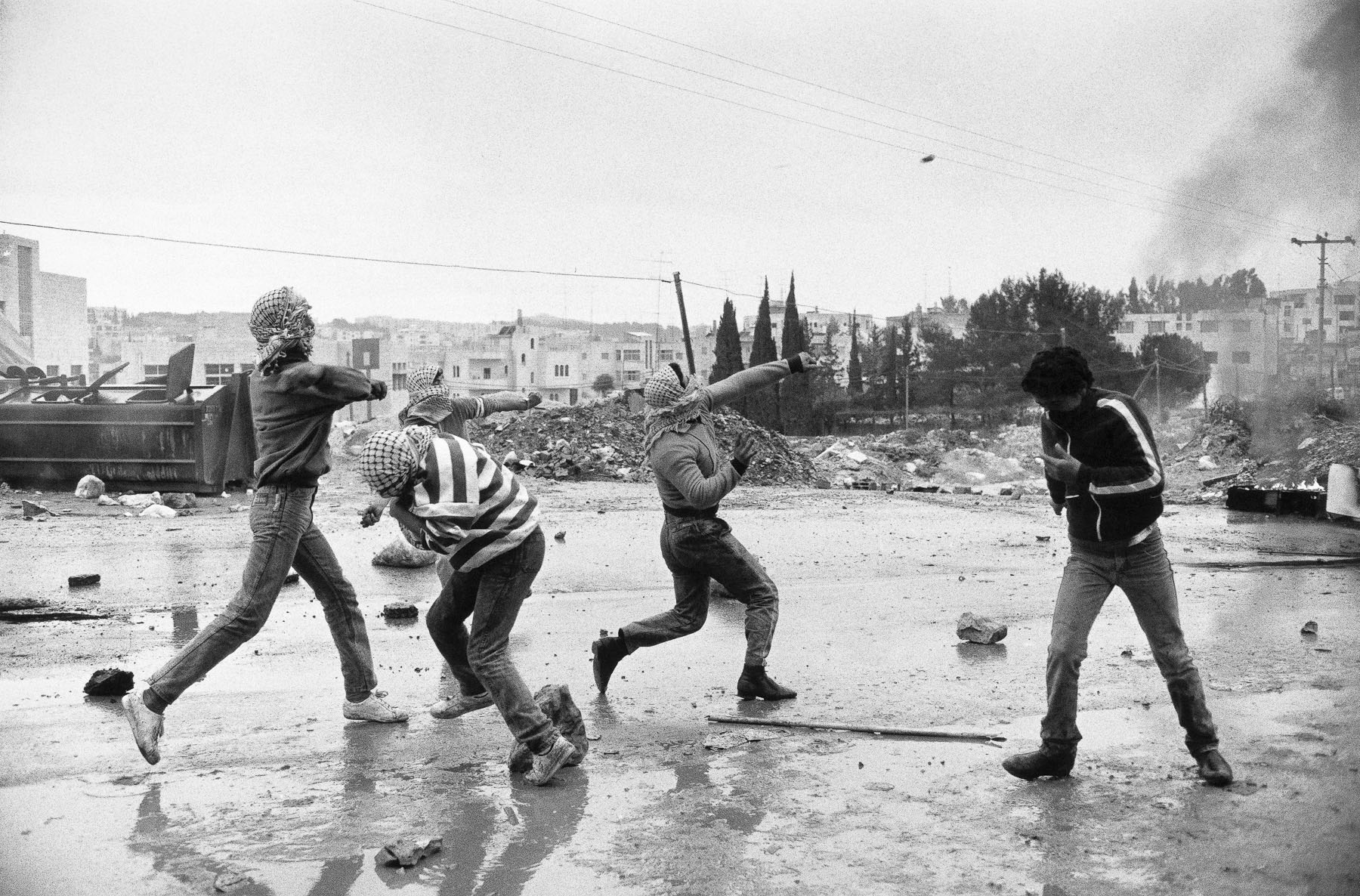 Young Palestinians throwing stones during a demonstration in January 1988