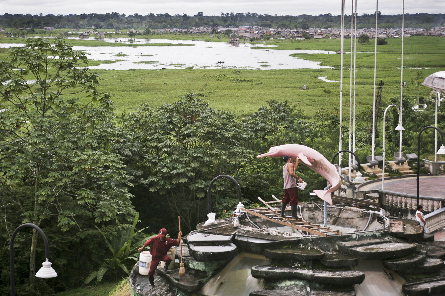 The statue of a pink dolphin on the Maldonado Malecon, promenade on the Amazon River on April 2005