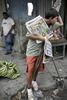 Belém area, newspaper seller on April 2005