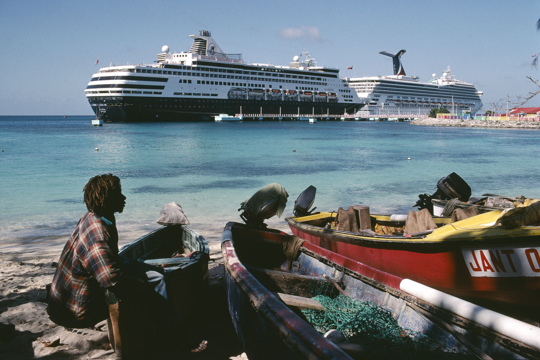 A Rasta fisherman in front of cruise ships in January 2001