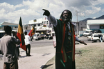 A leader of the Nyabinghi Rasta movement preaching during a ceremony in January 2001