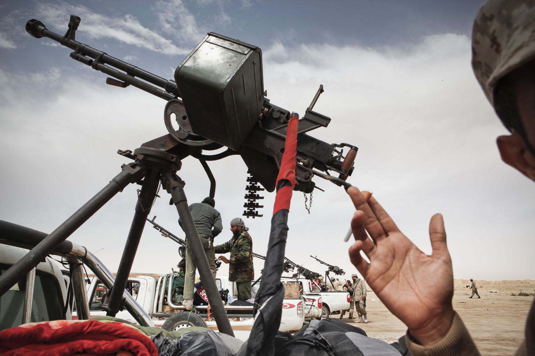 Libyan rebels prepare heavy machine guns before heading to the battle front in April 2011