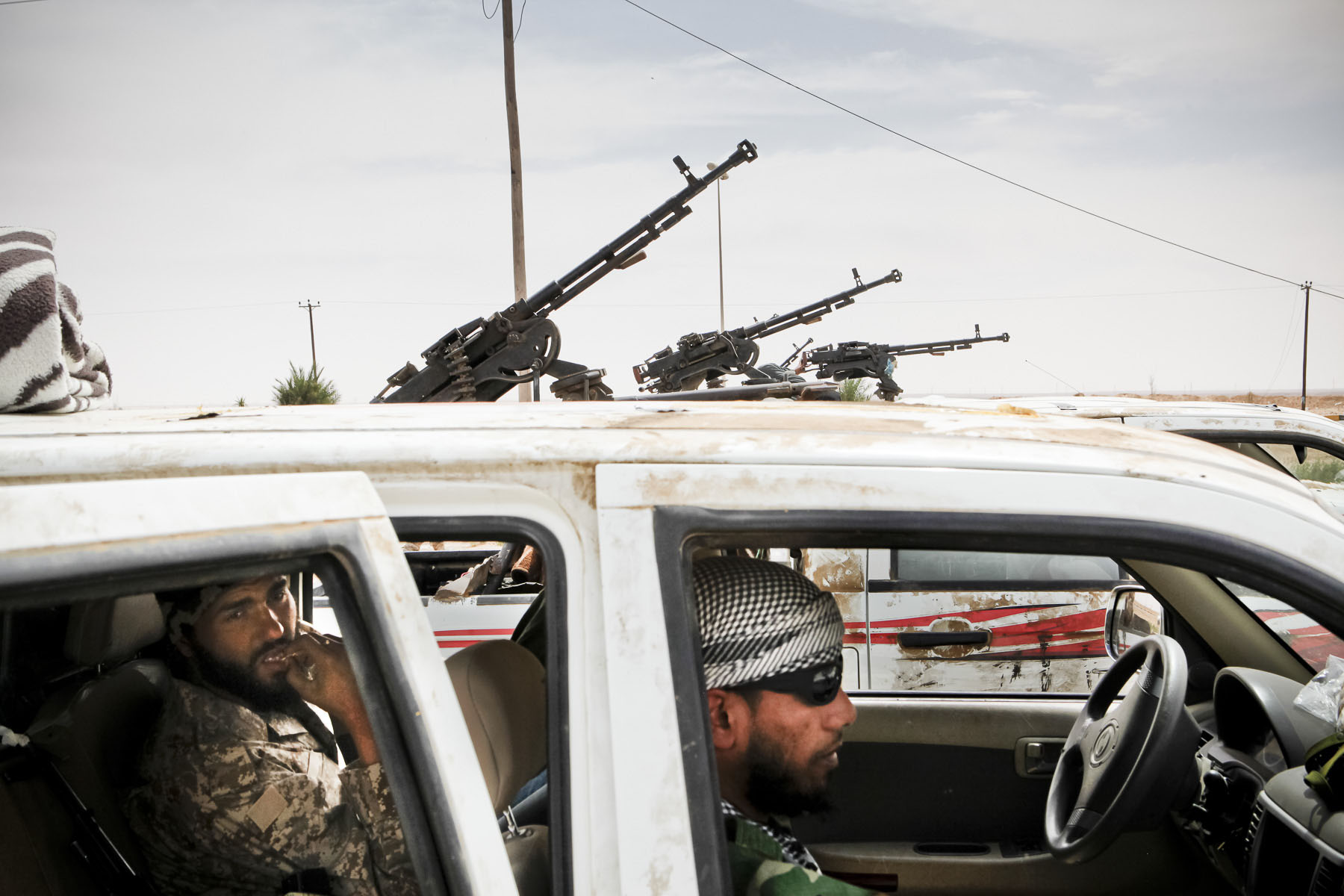 Libyan rebels move  to the battle front in April 2011