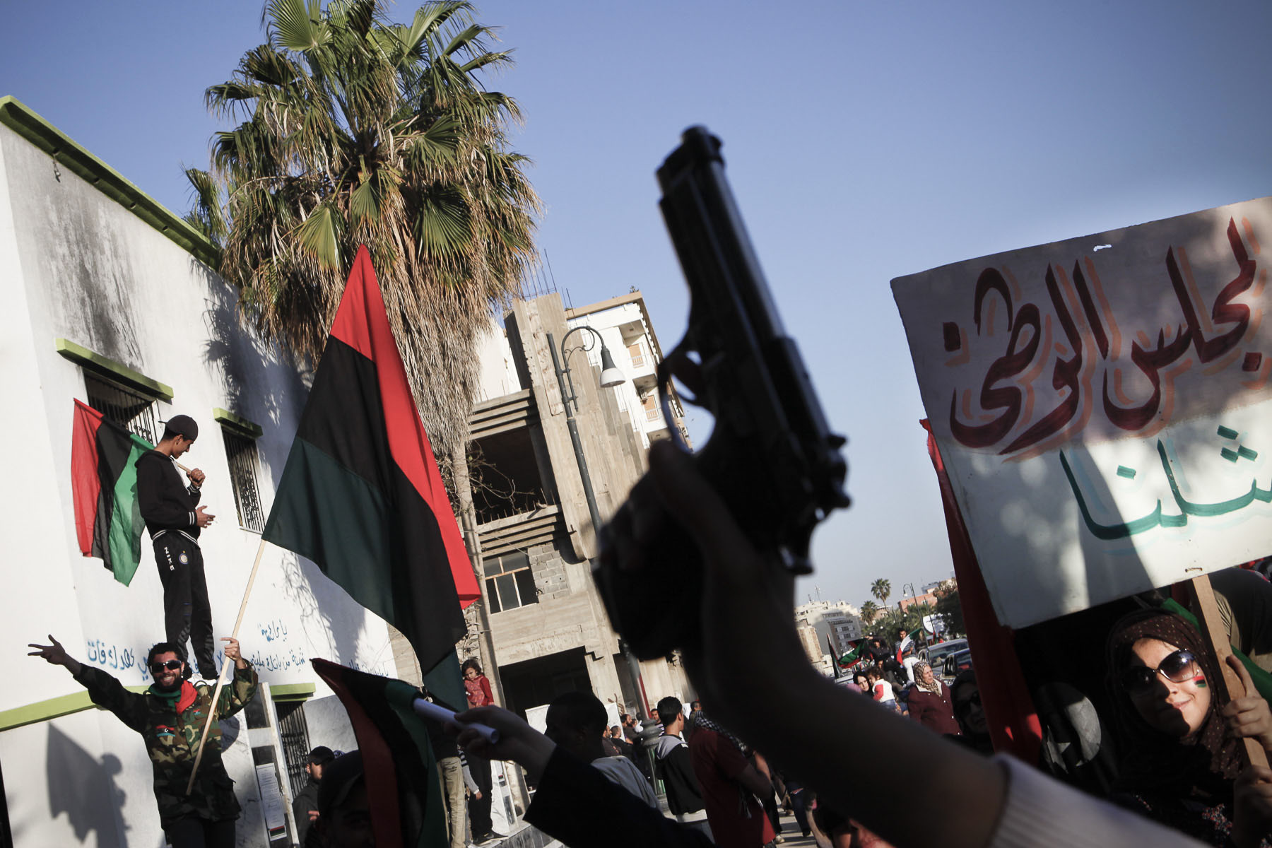 Libyan women demonstrate with false weapons to ask more military aid in April 2011