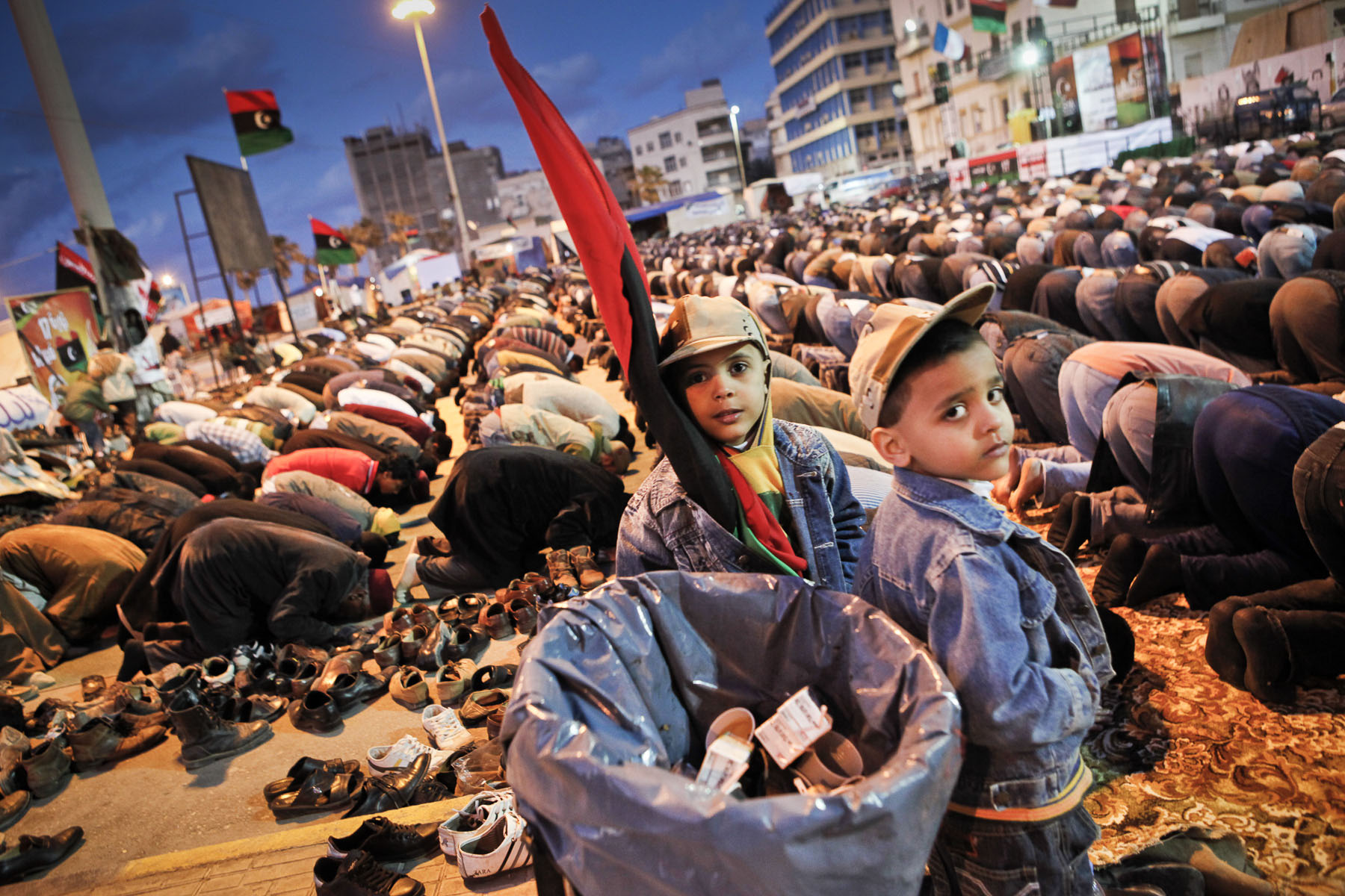 Young boys wait for their father during the evening prayer on the new Tahrir Square (Liberty Square) of Benghazi in April 2011