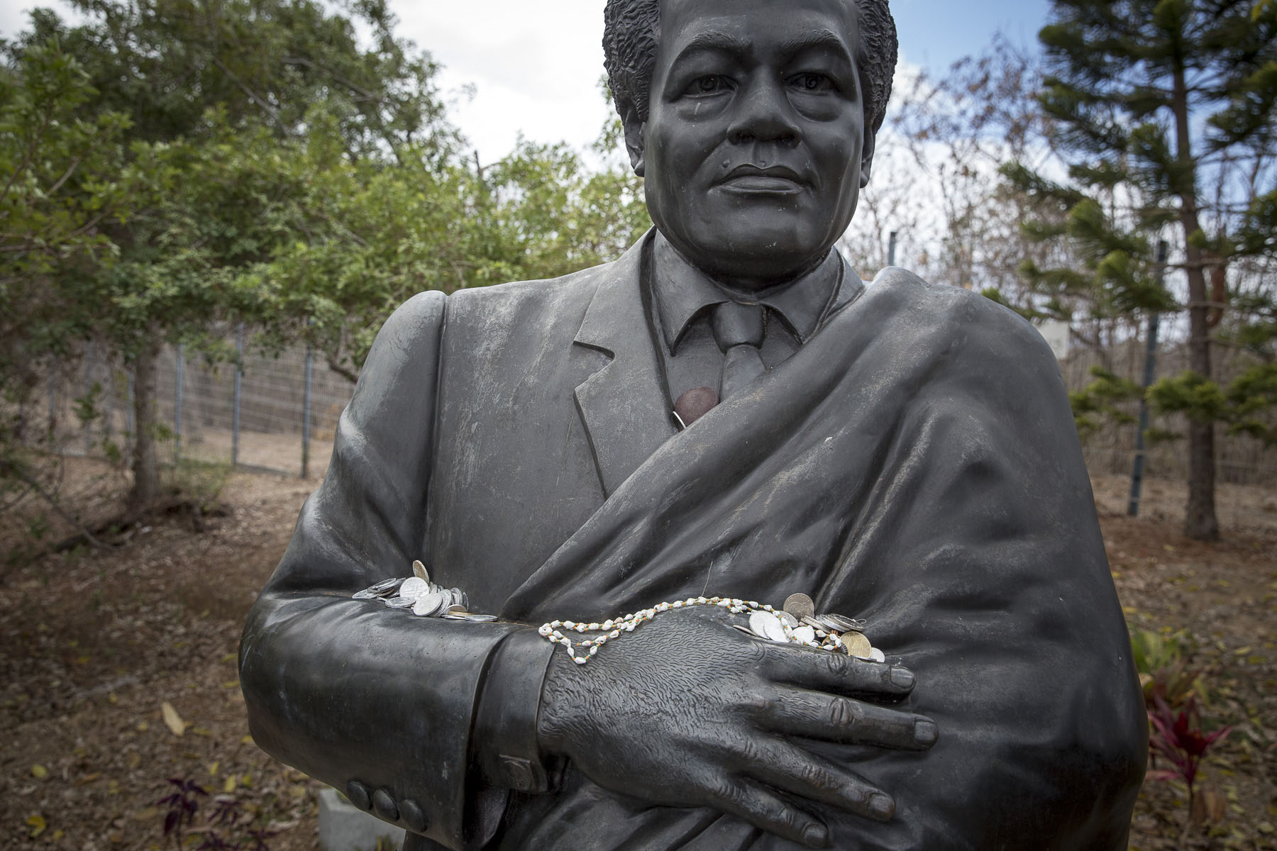 The statue of Jean-Marie Tjibaou at the Tjibaou Cultural Center regularly receives offerings, November 2017