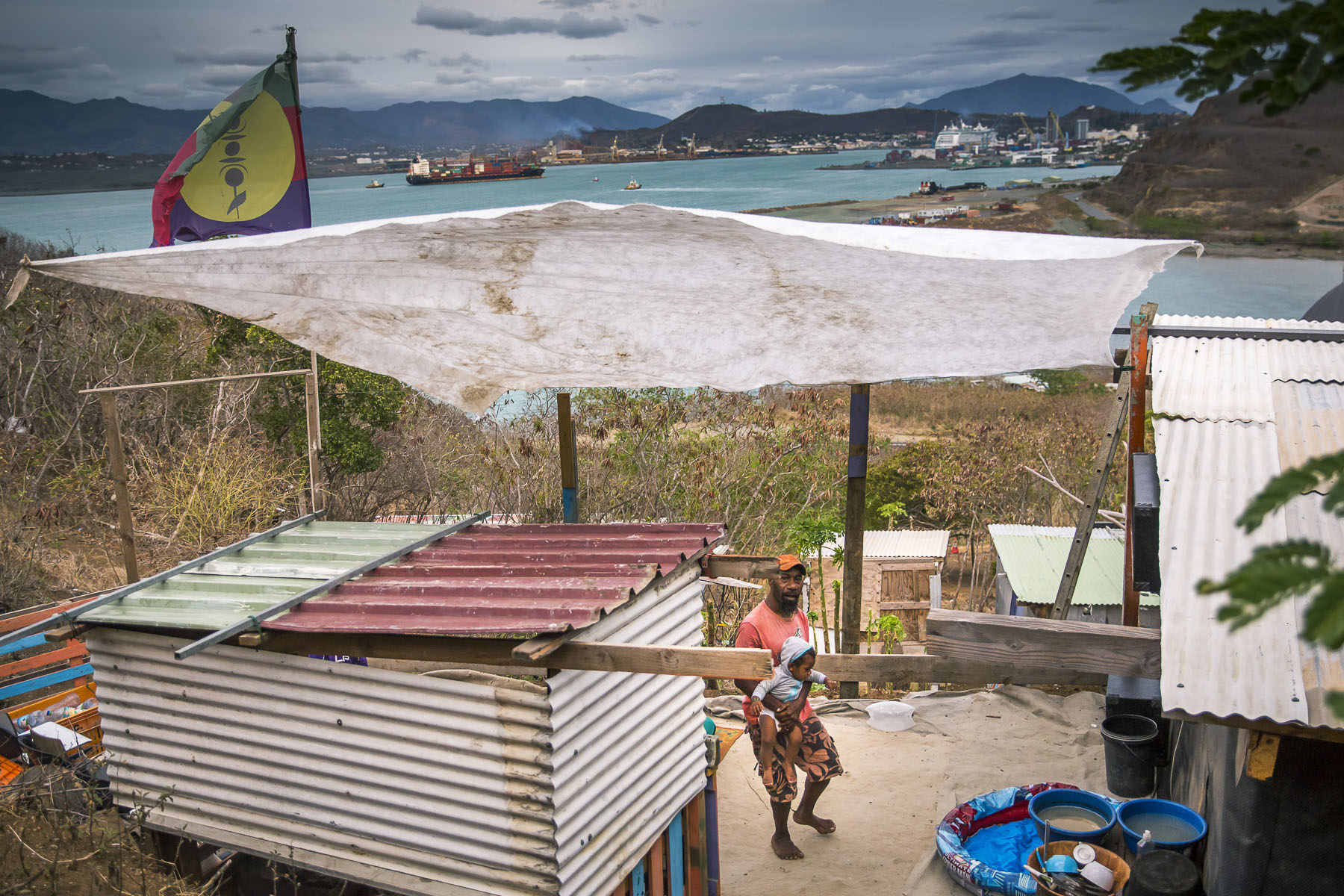 Due to lack of housing, the New Caledonians, mostly Kanaks, looking for work in the city built huts with recycled materials on vacant land on the peninsula of Nouville behind the University of New Caledonia and facing the downtown Noumea. The squats of Noumea would welcome today more than 8000 people in an agglomeration of approximately 160 000 inhabitants. November 2017