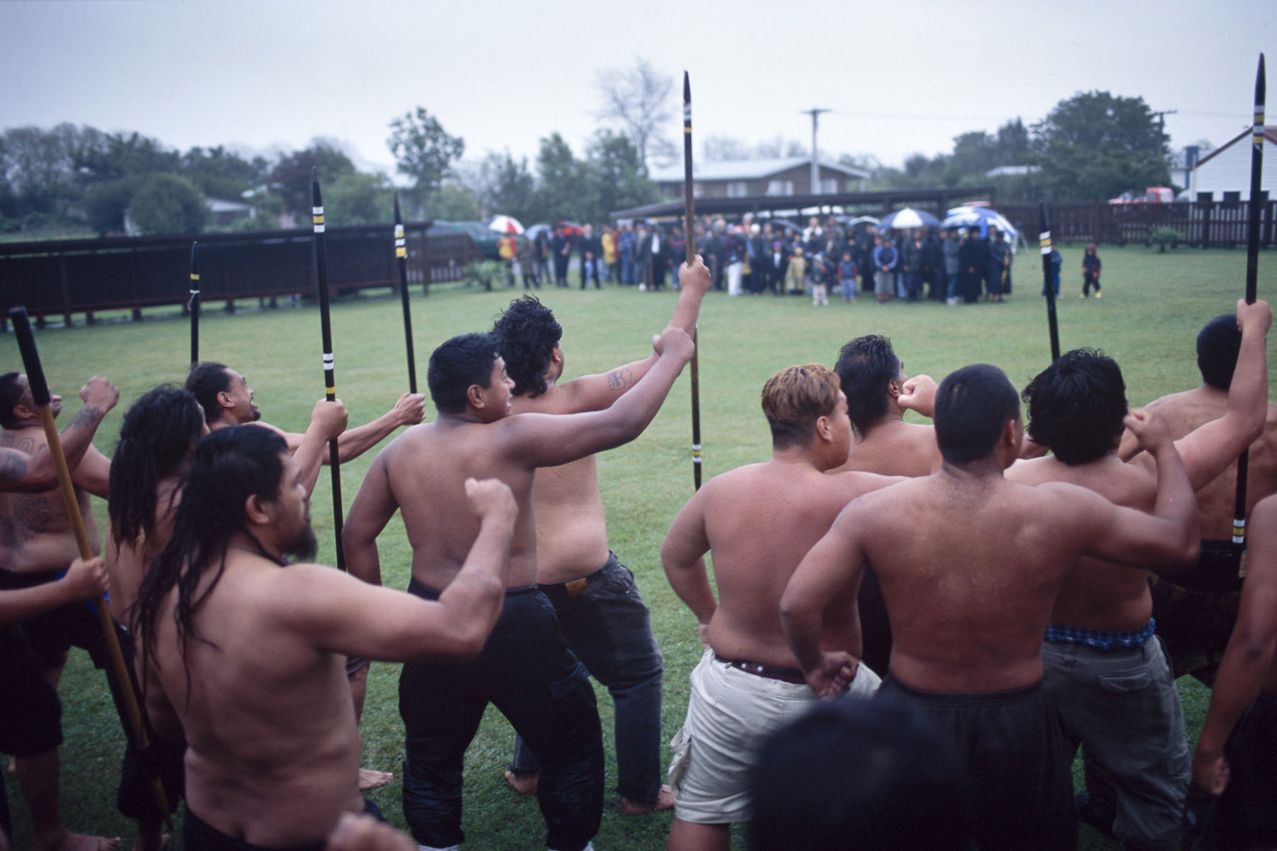 Maoris perform a haka, during a powhiri, traditional Maori welcoming ceremony before funeral in May 2000