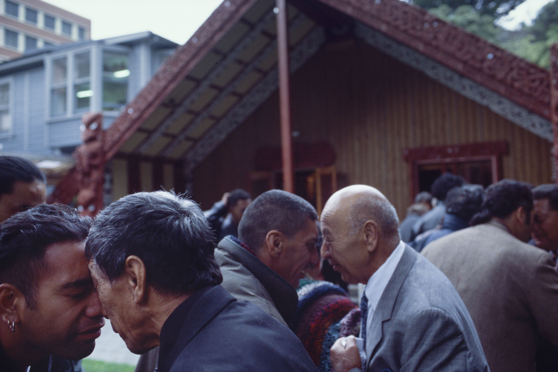 Maori men exchange a hongi, traditional Maori greeting during a powhiri, welcoming ceremony at Victoria University marae in May 2000