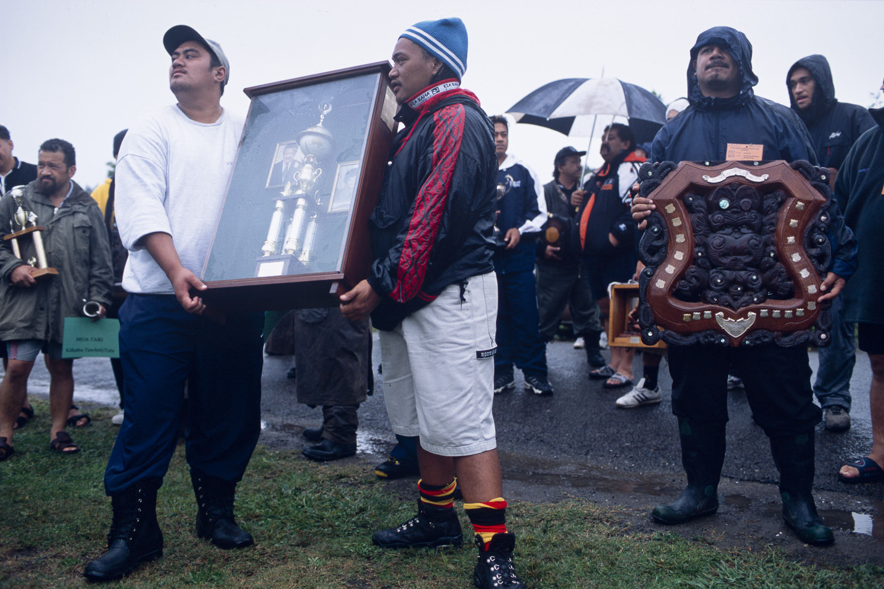 Maoris show trophies during a powhiri, traditional Maori welcoming ceremony before a funeral in May 2000