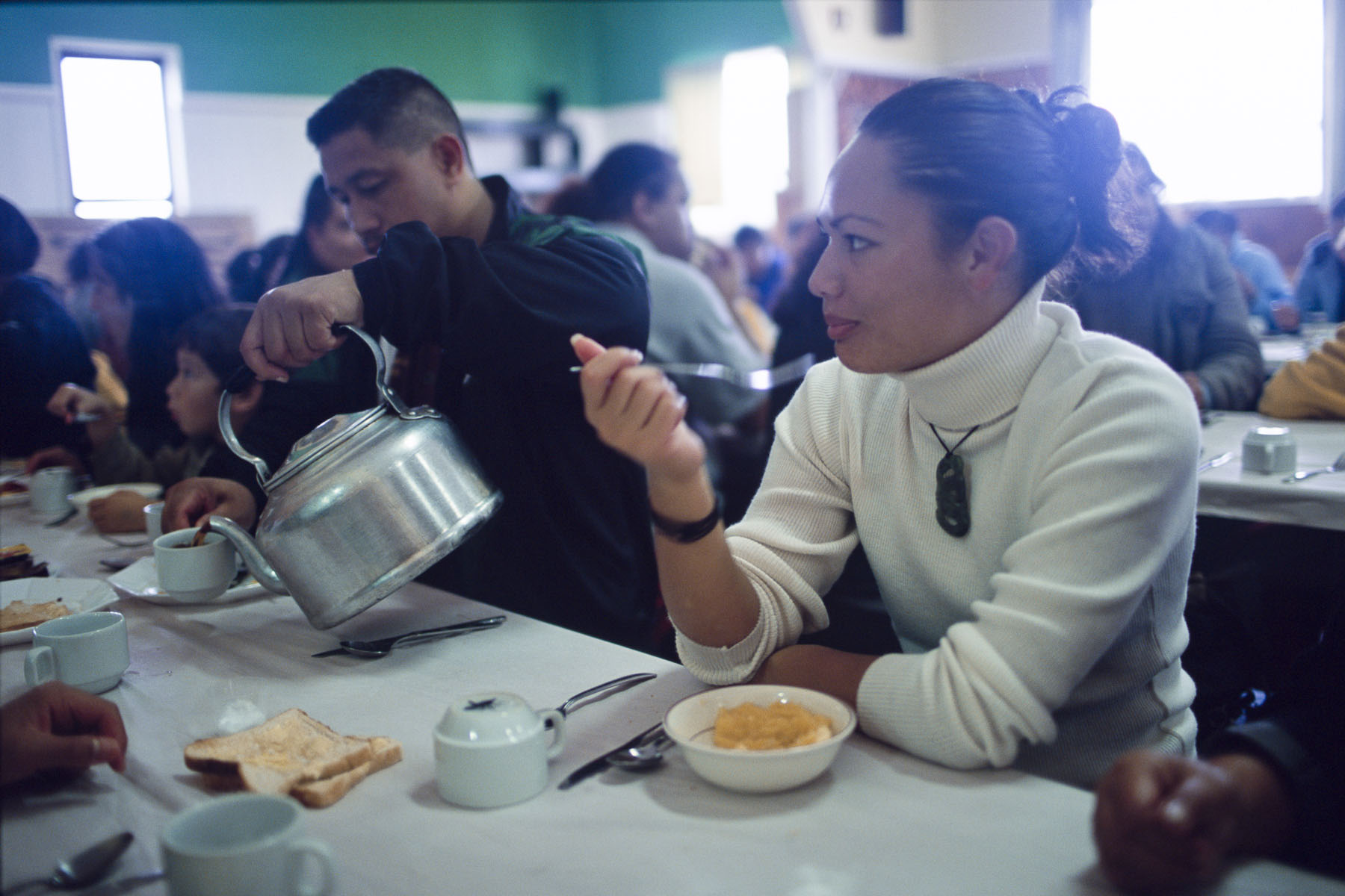 Maoris take breakfast after a funeral at the marae, traditional meeting place in May 2000