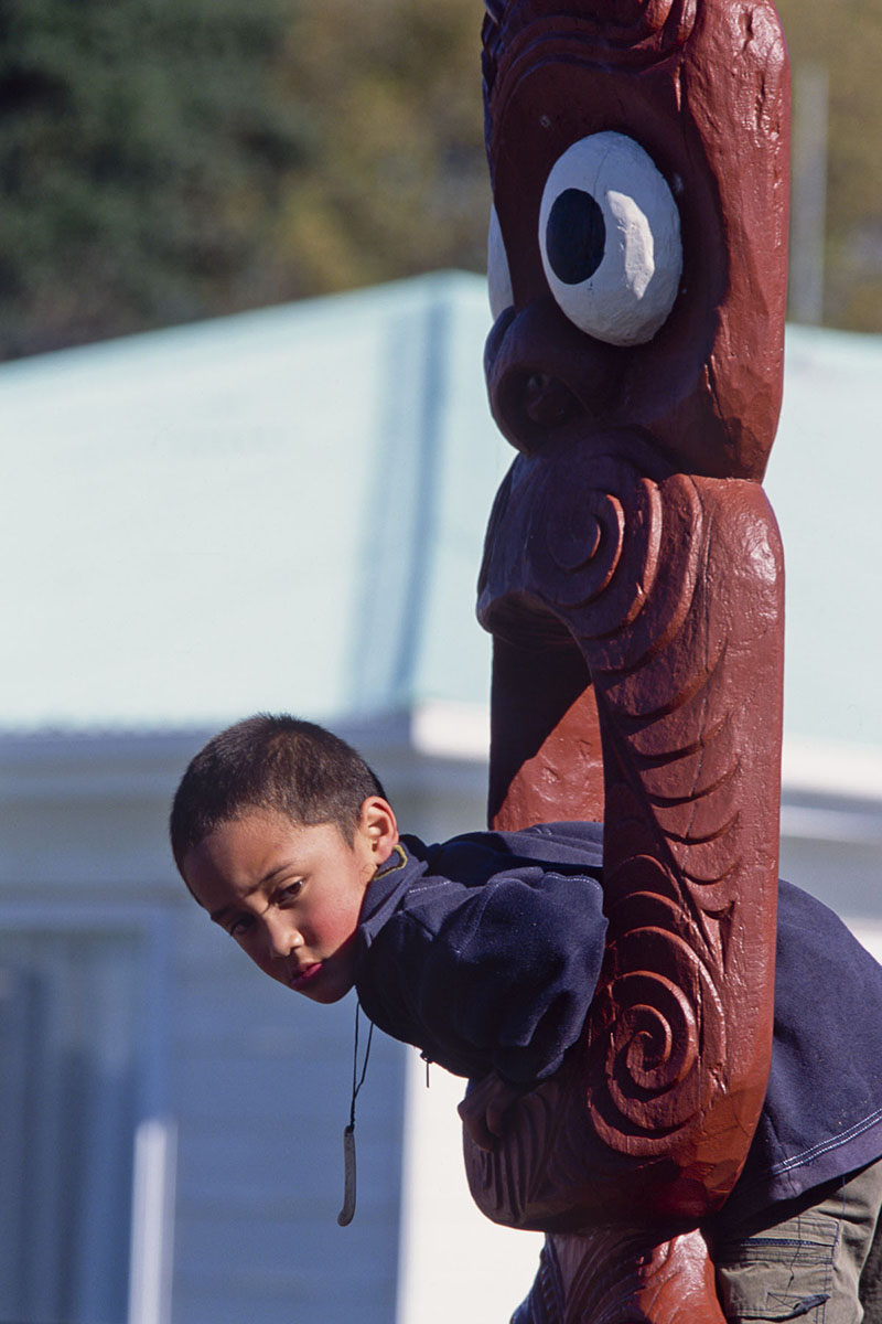 A Maori child plays by the marae, traditional meeting place in May 2000