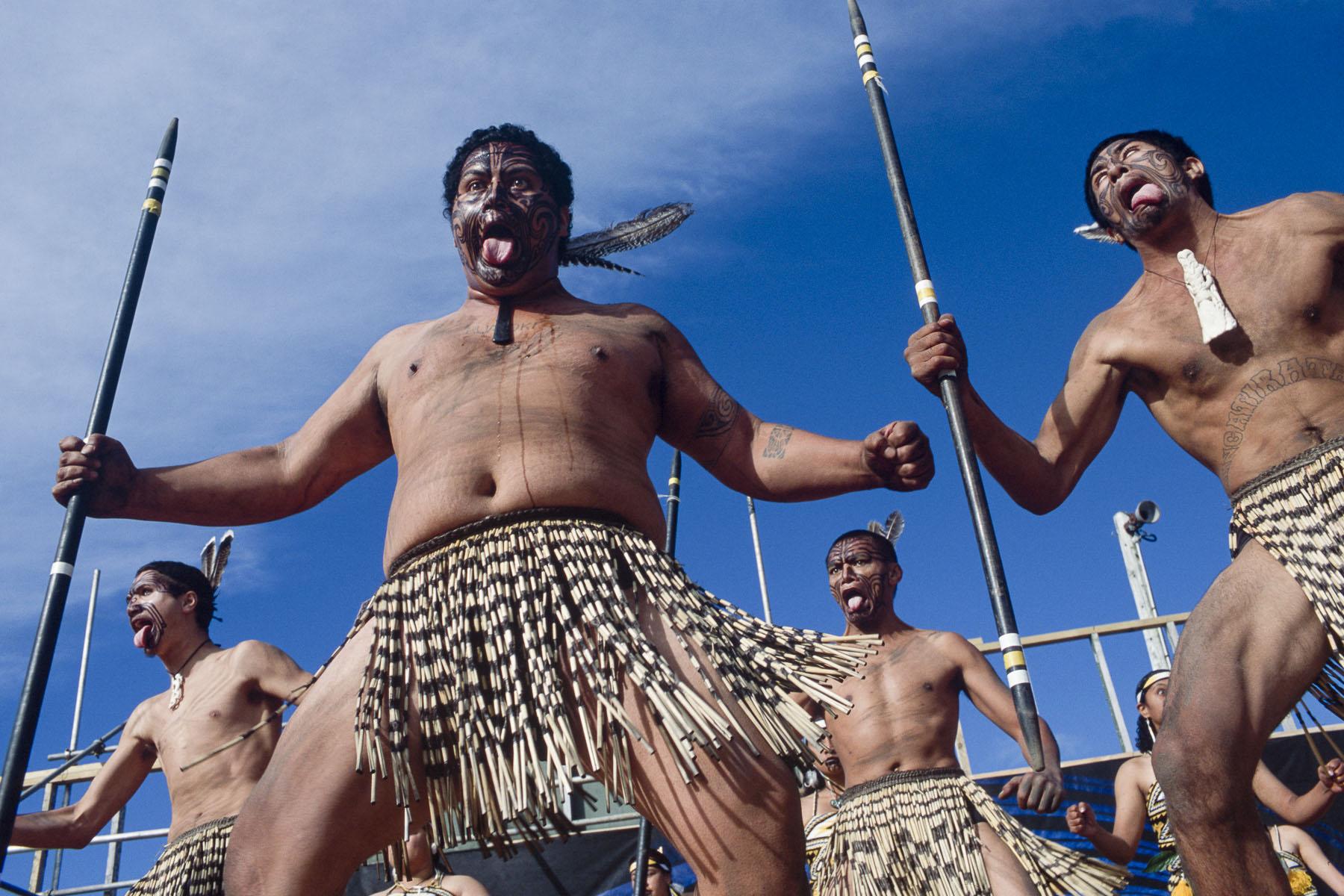 Maoris men perform a haka during a culture folk arts festival in May 2000
