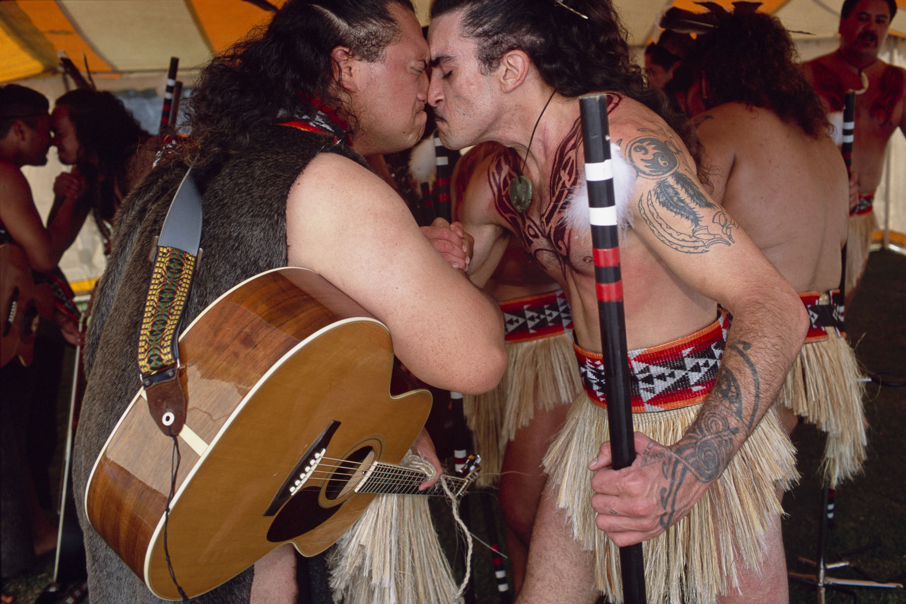 Maori men exchange a hongi, a traditional greeting, during a culture folk arts festival in May 2000