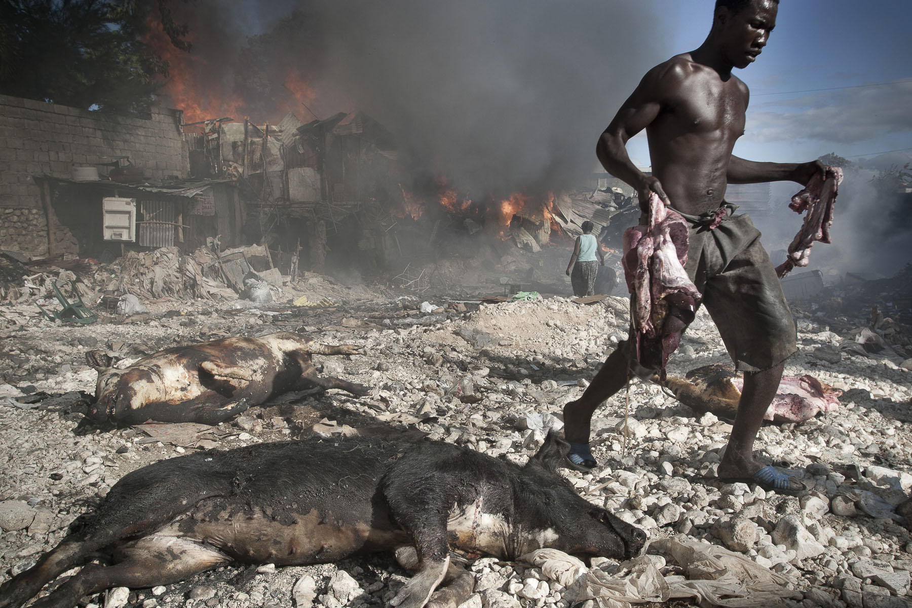 Fire at a pig seller's in Parc Charbon slums in November 2003