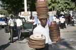Hats seller on the Champ de Mars in November 2003
