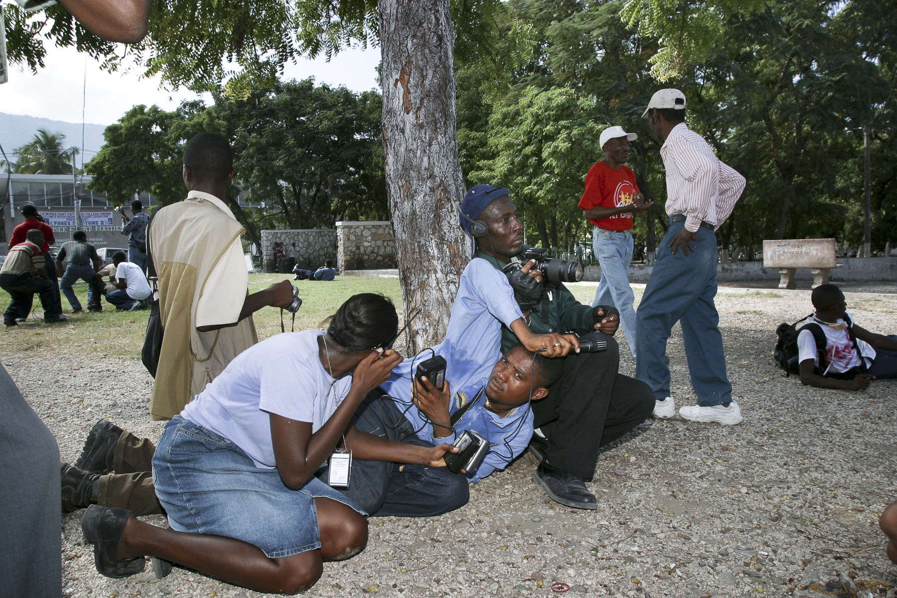 Journalists caught in the fire during a demonstration against President Aristide on the Champ de Mars in November 2003