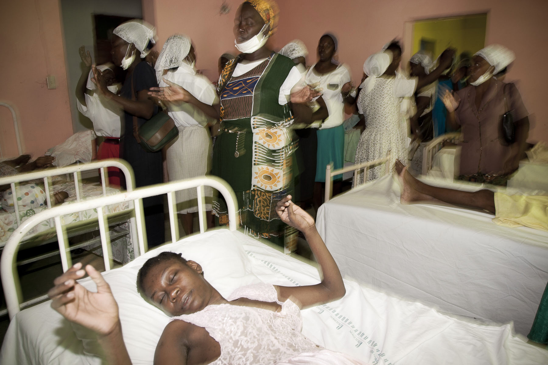 Believers of the Haiti First Christian Church visiting the sick at the Carrefour-Feuille sanatorium hospital in November 2003