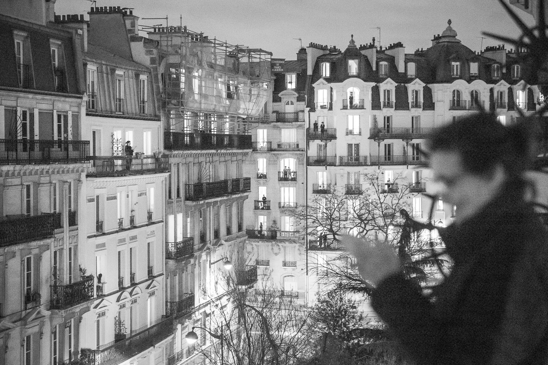 Rue Censier. Every evening at 8:00 p.m. confined Parisians go to their windows or balconies to applaud the healthcare workers who are fighting to save lives. March 2020