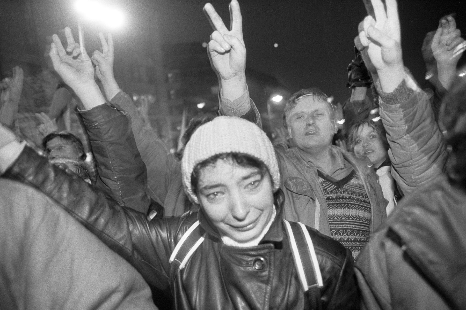 Prague inhabitants celebrate the collective resignation of the leaders of the Communist Party on  November 24, 1989