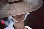 Saint-Tropez. A woman attends a traditional procession. 2000