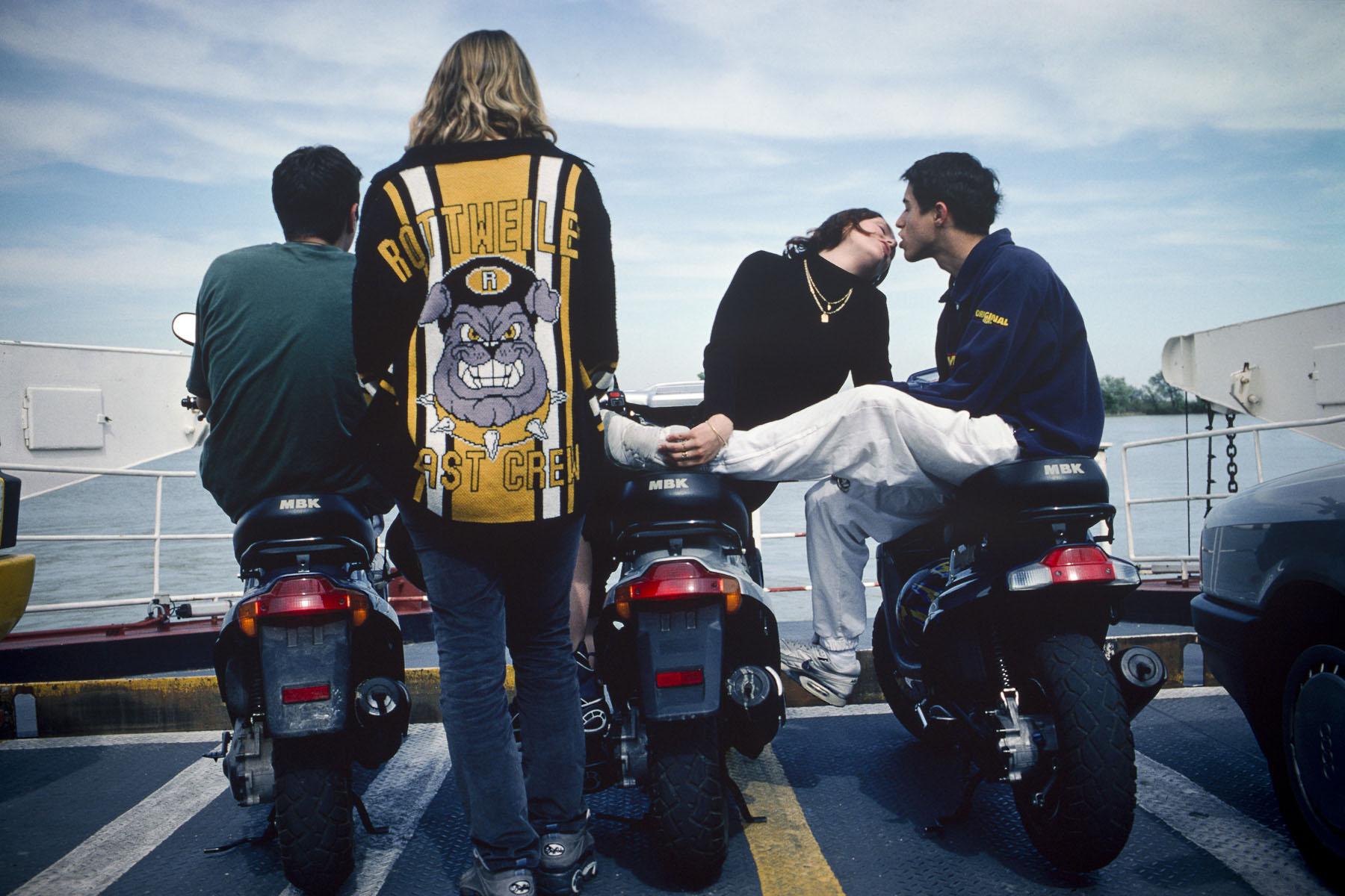 Teenagers crossing the Rhone river on a ferry to Port-Saint-Louis-du-Rhône. 2000