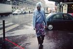 A man under the rain near the Old Port. 2000