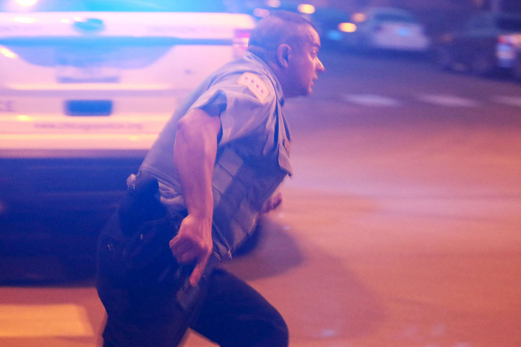 Police ran with their guns drawn toward the sound of gunshots coming from a crowd of people half a block from the scene they were investigating where four people were shot in the Austin neighborhood of Chicago.