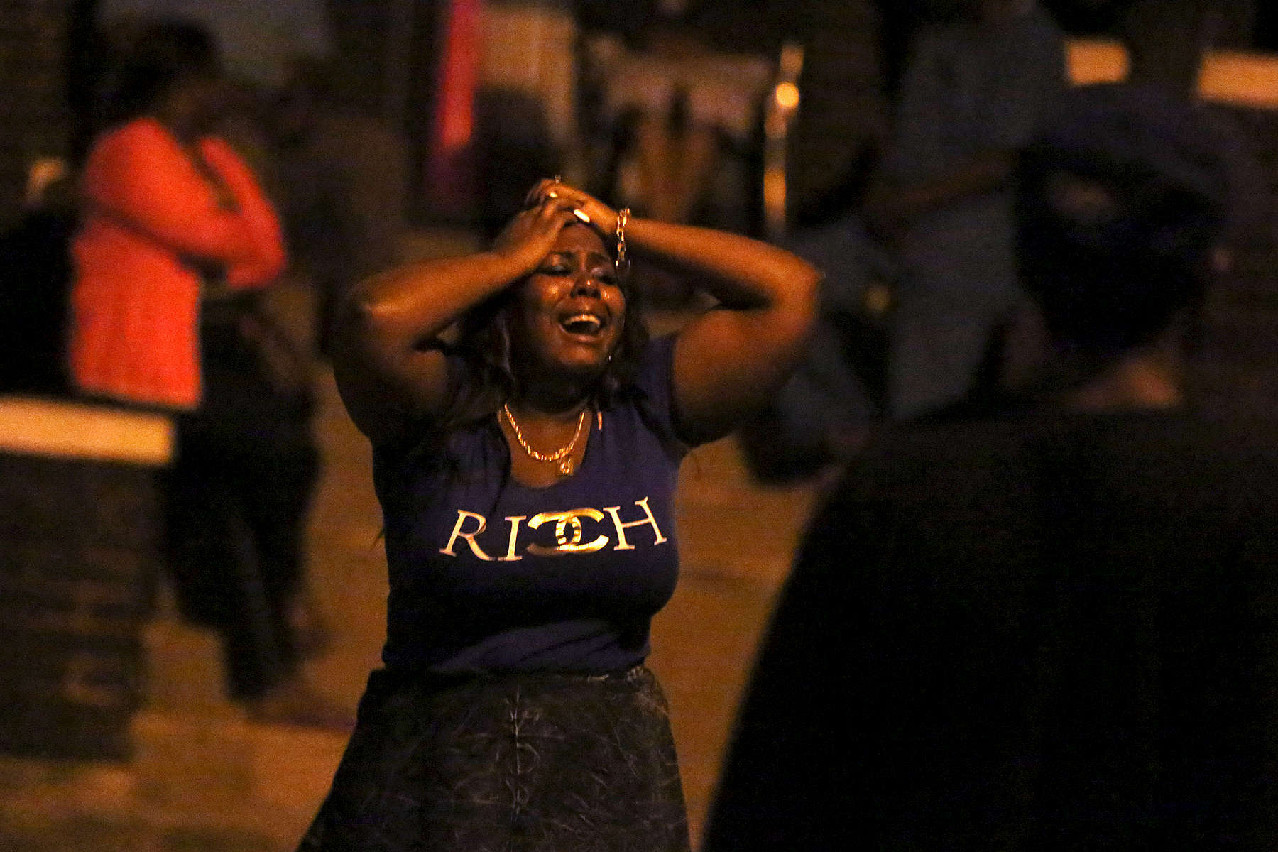 A woman grieves at the scene where three people were shot, including a 33-year-old man who died, in the North Austin neighborhood of Chicago. Witnesses at the scene said the victims were attending a relative's birthday party when the shooting occurred.