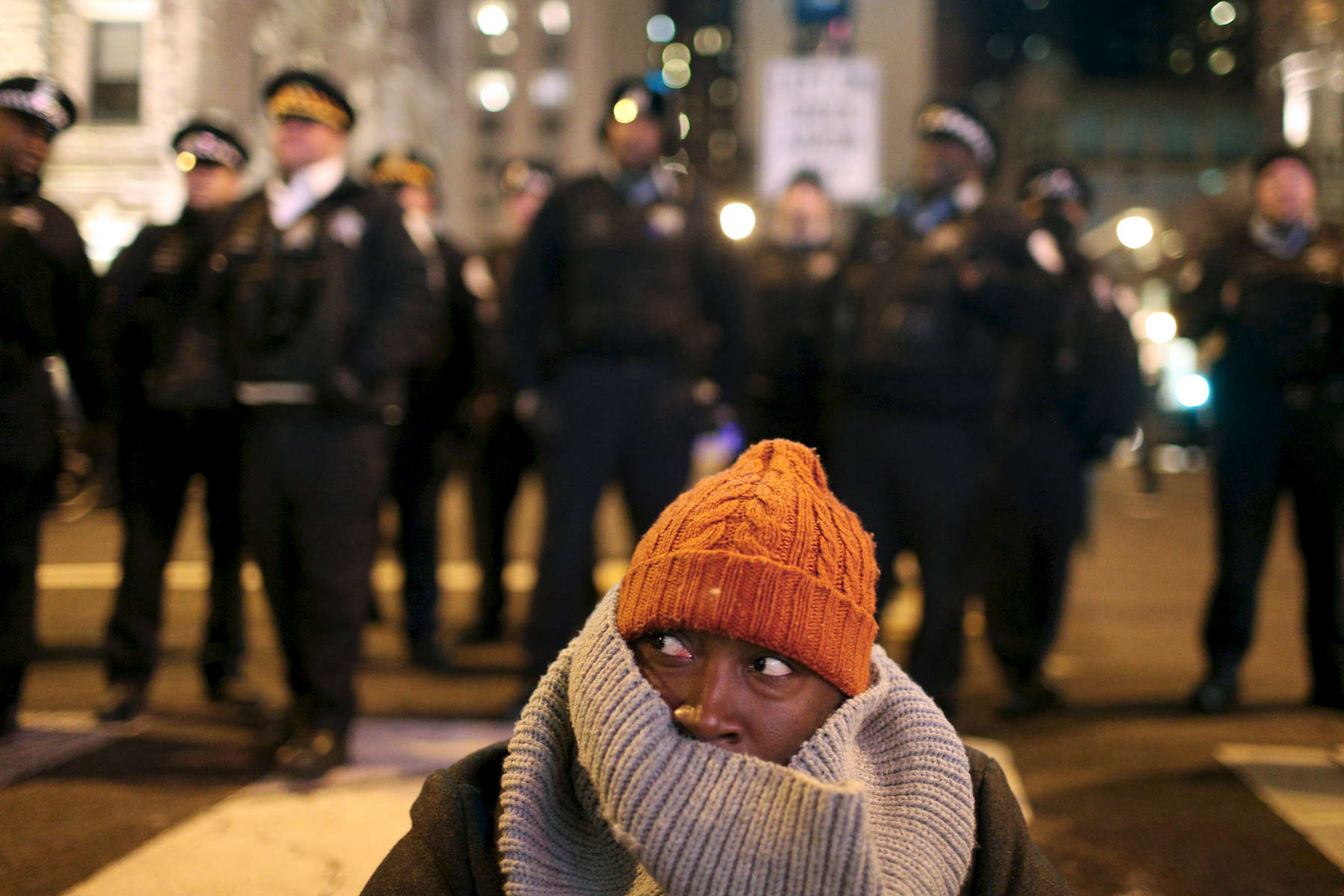 A protester lays in the roadway shutting down traffic in support of police shooting victim Laquan McDonald during the Black Friday shopping rush on Michigan Avenue in Chicago. Days later store staff and managers said that Black Friday sales on the Magnificent Mile were 25 percent to 50 percent below projections.