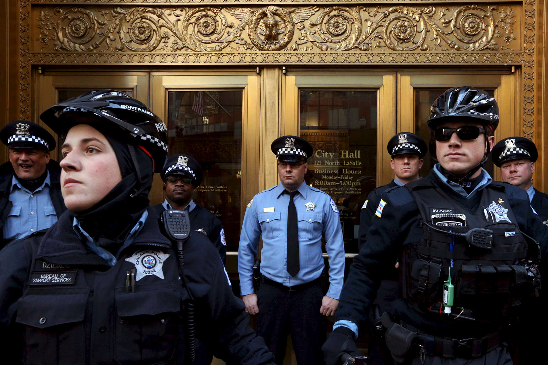 Chicago police officers block an entrance to City Hall as protesters march through the Loop calling for Mayor Rahm Emanuel to step down in response to the shooting death of Laquan McDonald by police in Chicago.