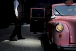 A pink vintage London taxi, the Langham hotel's signature house car, sits ready for guests on North Wabash Avenue in Chicago.