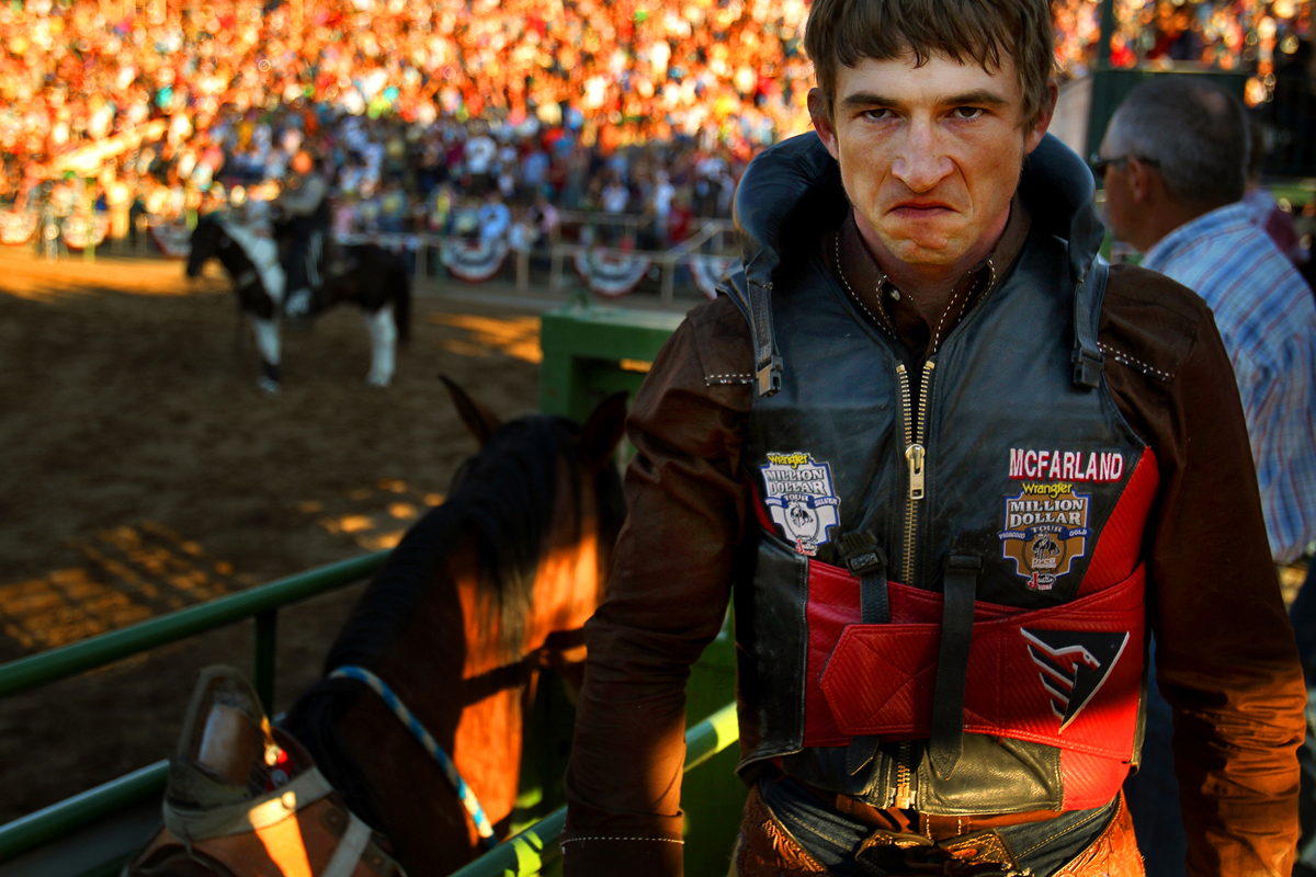Bareback rider Tom McFarland of Wickenburg, Ariz. psychs himself up before riding Mama Mia during the Pioneer Days Rodeo at Lorin Farr Park's Pioneer Stadium in Ogden, Utah.