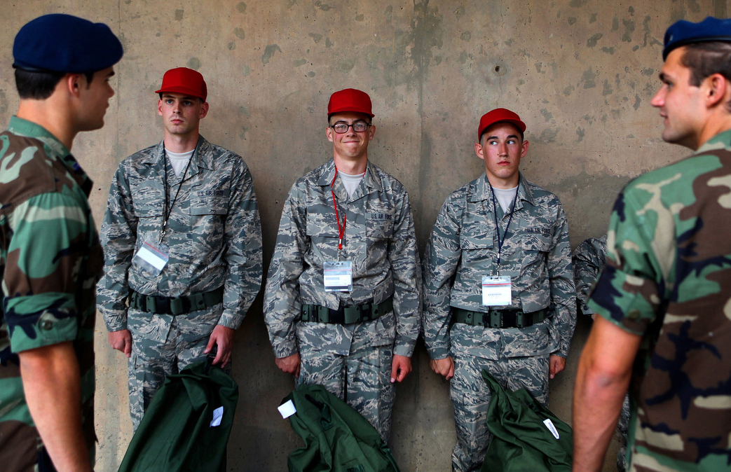 Shane Simonson, center, of Fort Collins stands with his fellow doolies after receiving their Airman Battle Uniforms during the freshman intake process at the Air Force Academy in Colorado Springs, Colo.