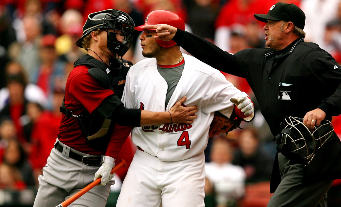 Houston catcher Justin Towles tries to restrain Cardinals' Yadier Molina as he charges towards pitcher Brandon Backe over a questionable inside pitch during a game between the St. Louis Cardinals and the Houston Astros at Busch Stadium in St. Louis.