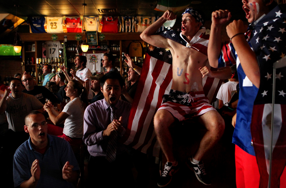 Will Mandino, 17, (with no shirt) of Colorado Springs reacts to a goal while watching the United States men's soccer team play a World Cup match against Ghana at McCabe's Tavern in Colorado Springs, Colo.