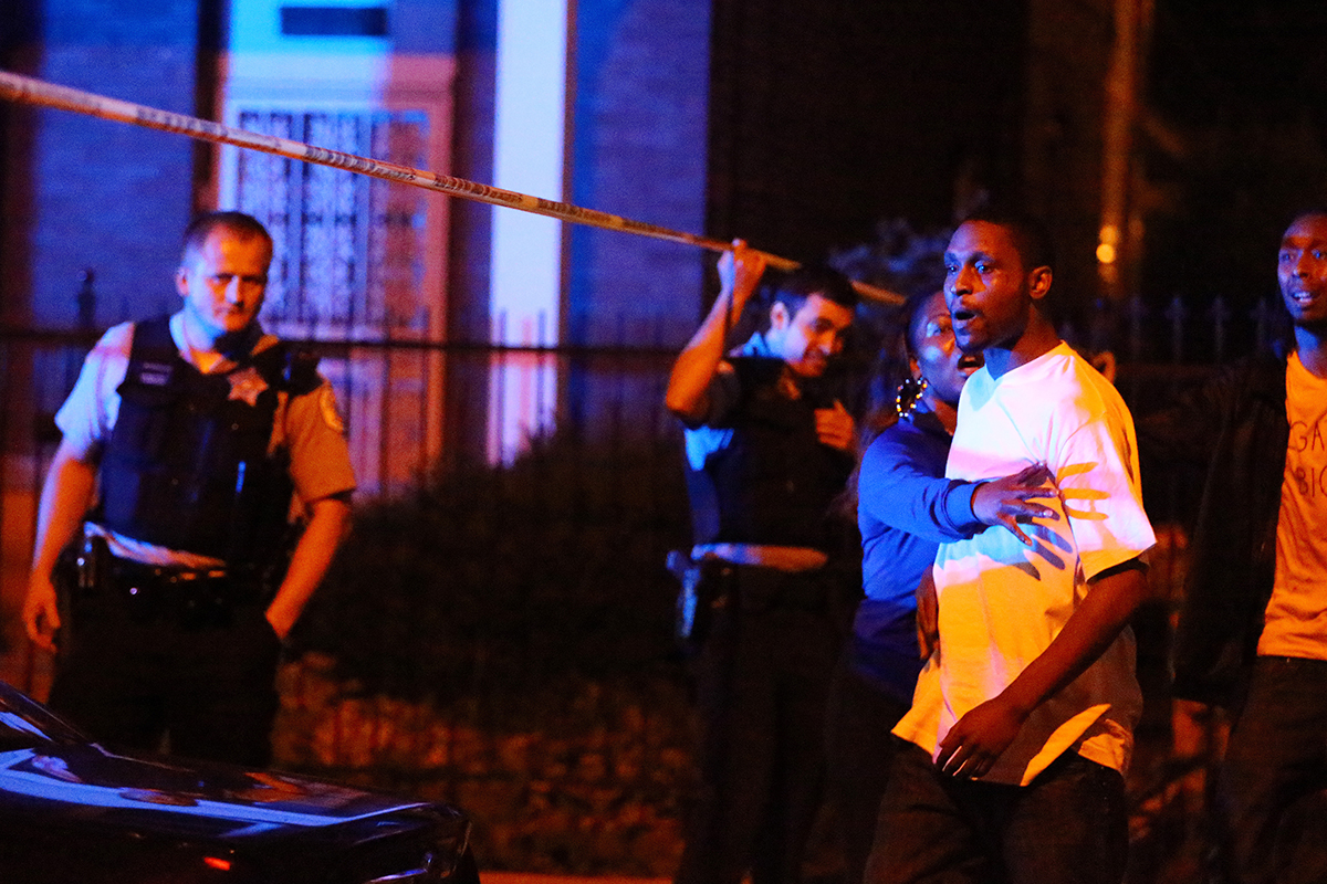 Chicago police clash with the brother of a man who was shot and killed by police after he pointed a gun at them in the 1600 block of South Springfield Avenue in Chicago.