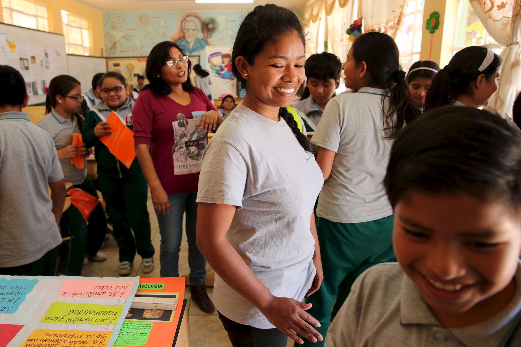 Students are greeted by Miluska Elguera as they file into their classroom at Ricardo Palma School in San Juan de Marcona, Peru. The students are part of an outreach program with Punta San Juan where Elguera comes by occasionally to educate them and spread awareness about the reserve.